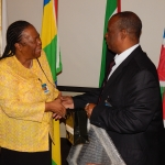 Education Minister, Dr. Michael Kaingu, receives a gift from South African Minister of Science and Technology, Ms. Naledi Pandor at the 2nd Ministerial SKA meeting in Pretoria on 25th March, 2015.